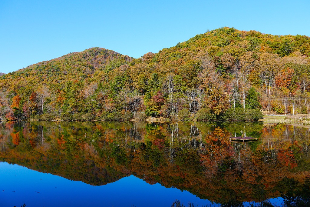 The fall colors reflected on the glassy surface of Lake Trahlyta.